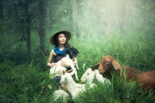Working women with goat in thailand