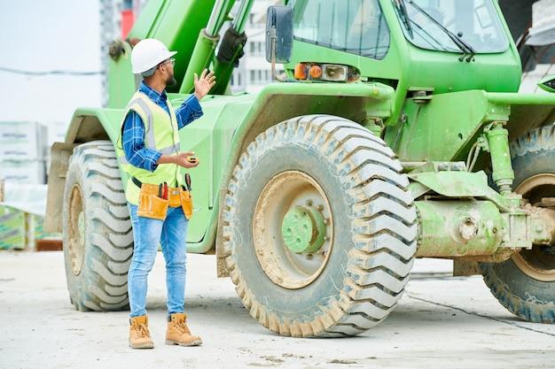 Workman by industrial excavator