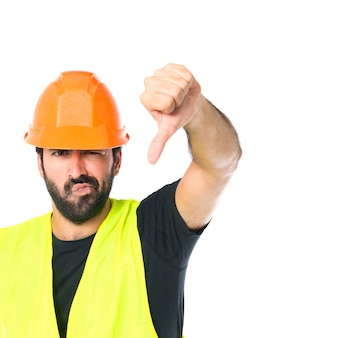 Workman doing a bad signal over white background