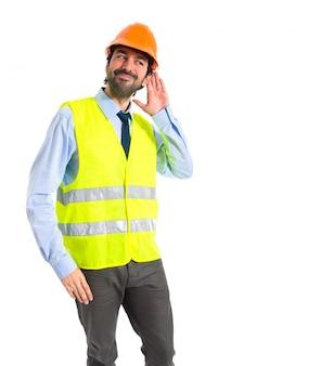 Workman listening something