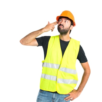 Workman making suicide gesture over white background