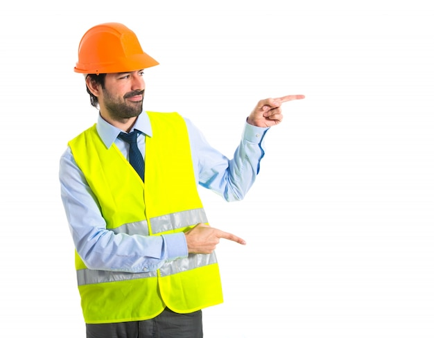 Workman pointing to the lateral