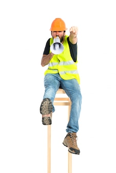 Workman shouting over isolated white background
