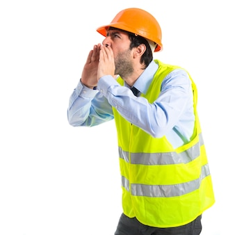 Workman shouting over white background