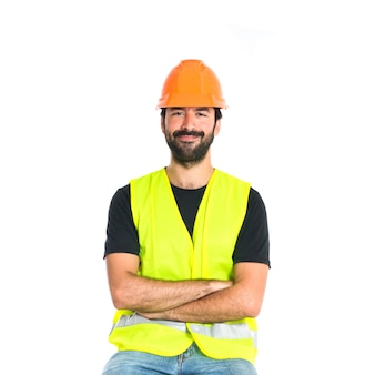 Workman with his arms crossed over white background