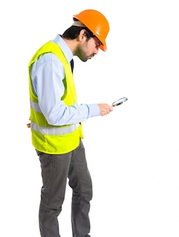 Workman with magnifying glass