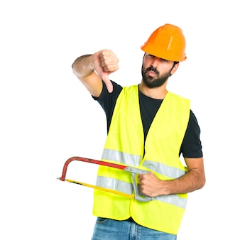 Workman with thumb down holding a hacksaw