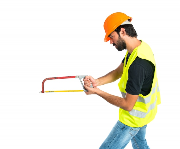 Workman with thumb up holding a hacksaw