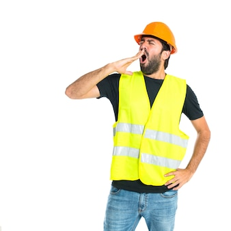 Workman yawning over isolated white background