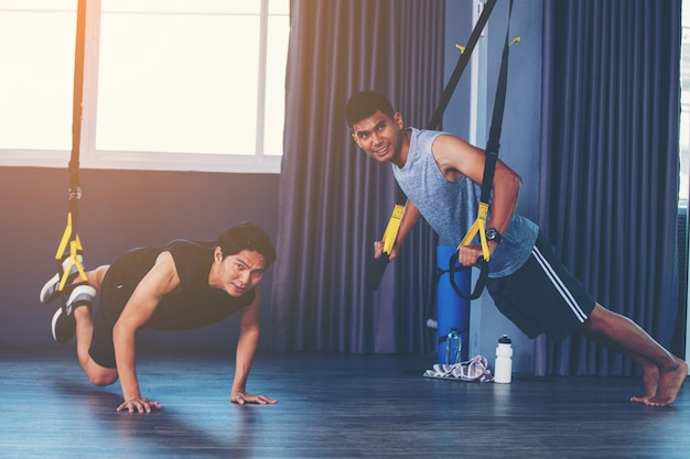 Workout concept; young people practicing workout in class