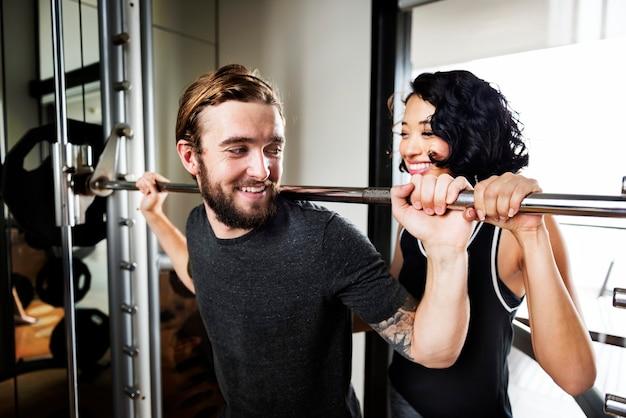Workout couple sport-wear muscular hobby concept