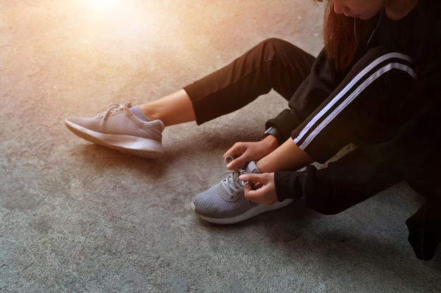 Workout diet concept, runner trying running shoes get ready for run.