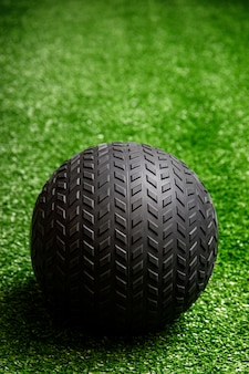Workout exercise or fitness ball in gym on the grass