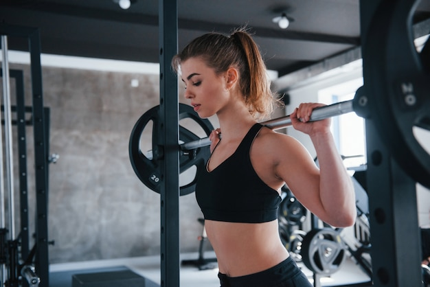 Workout routine. photo of gorgeous blonde woman in the gym at her weekend time