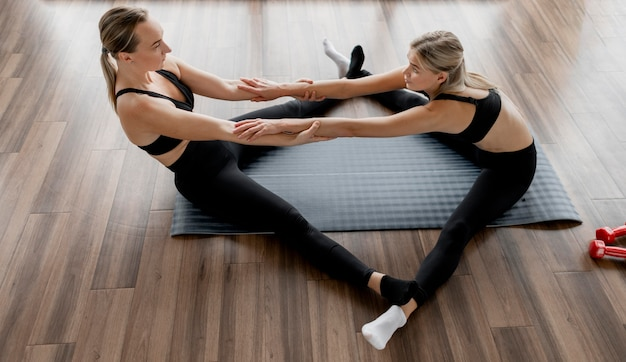 Workout with personal trainer high view long shot