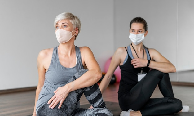 Workout with personal trainer wearing masks