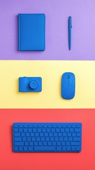 Workplace accessories on a three-color surface. stylish accessories for business and freelancing. flat lay.