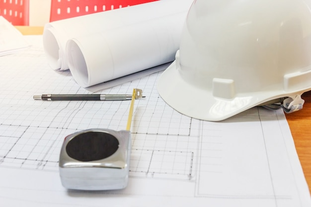 Workplace of architect - architectural project, blueprints, blueprint rolls, pen and measu