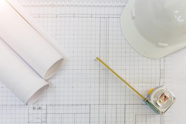 Workplace of architect - architectural project, blueprints, blueprint rolls, pen