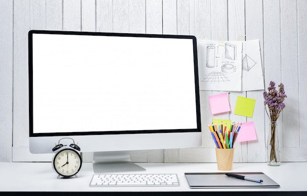 Workplace background for designers with blank white screen modern desktop computer.