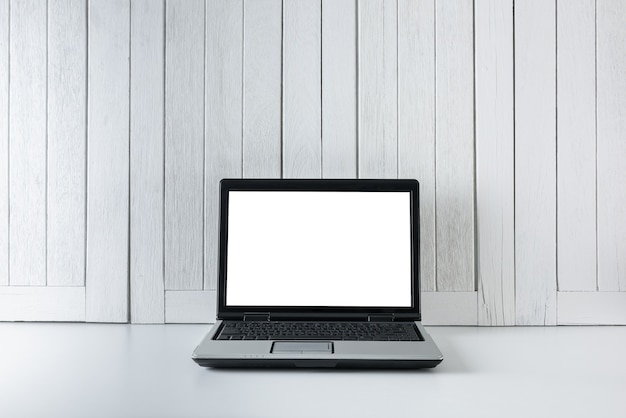 Workplace background with blank white screen modern laptop computer