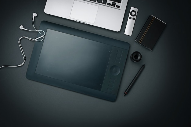 Workplace of business. modern male accessories and laptop on black background
