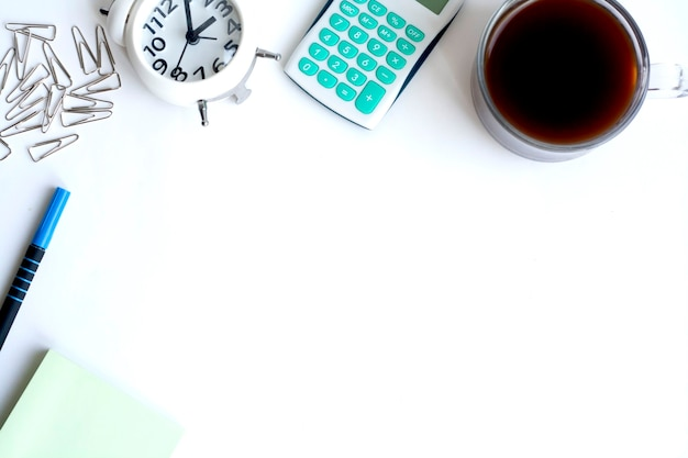 Workplace, clock, calculator, note paper, paper clips, pen and coffee on white background, copy space