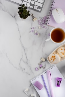 Workplace elements on marble table top view