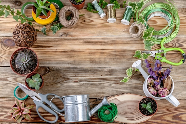 Workplace florist. top view. copy space. wooden background.