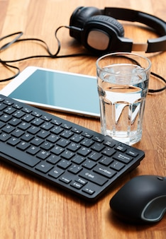 Workplace and glass of water
