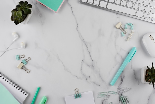 Workplace items on marble table