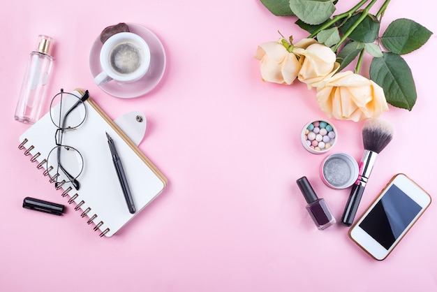 Workplace mockup with notebook, glasses, roses, phone and accessories