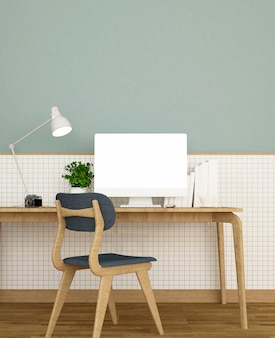 Workplace on white ceramic wall and green wall decorate in home or apartment