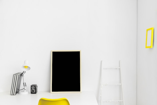 Workplace in white and yellow colors with blackboard