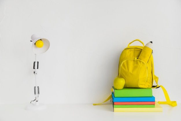 Workplace with books and yellow backpack