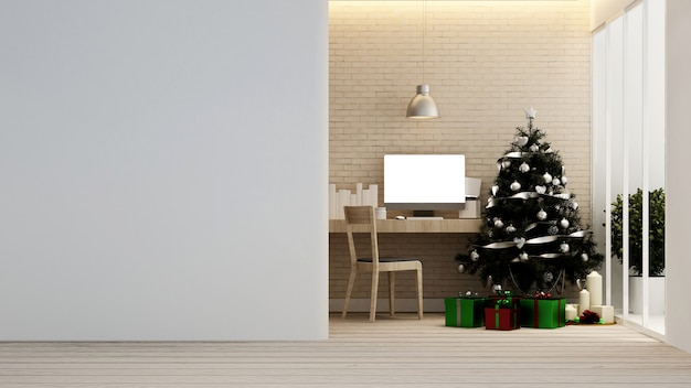 Workplace with christmas tree and gift box in home or apartment