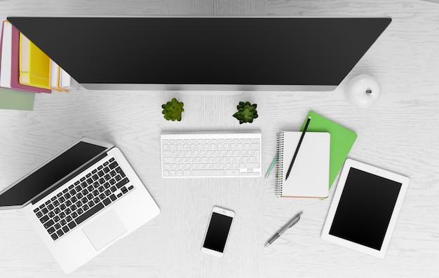 Рабочее место с компьютером, планшетом, смартфоном и прочими вещами