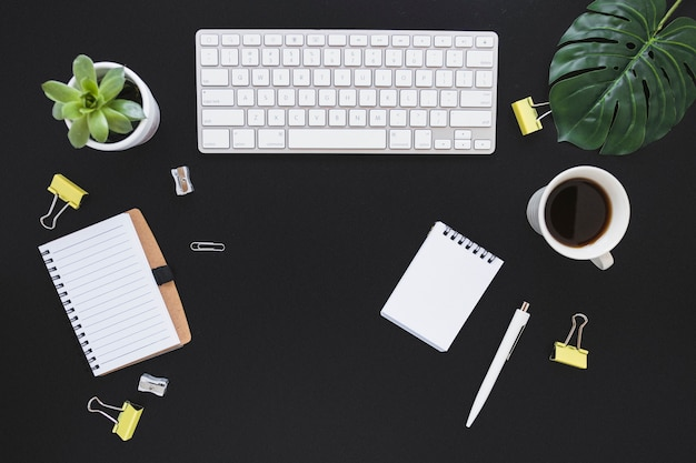 Workplace with keyboard cup and stationery