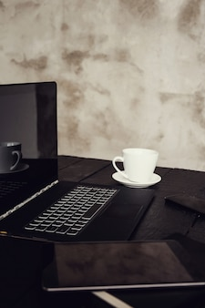 Workplace with laptop and coffee cup