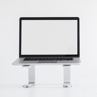 Workplace with laptop on stand
