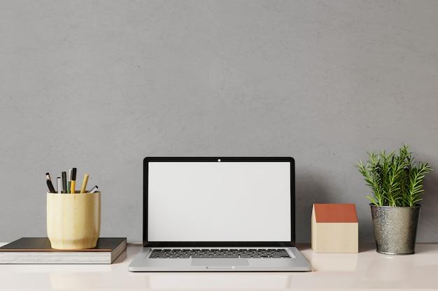 Рабочее место с ноутбуком белый экран и бетонные фоне стены.