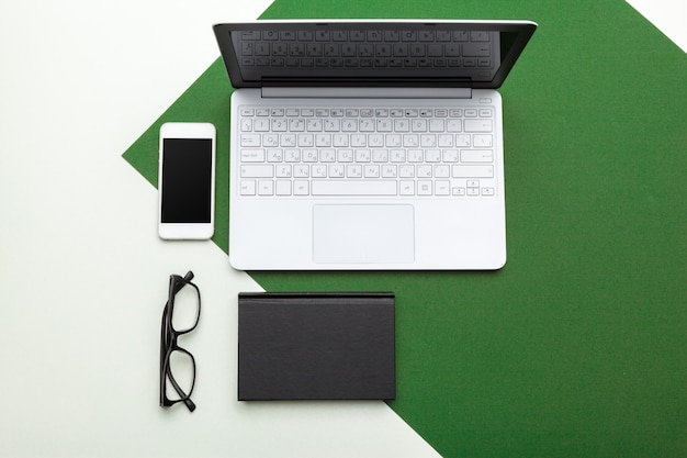 Workplace with notebook laptop. comfortable work table in office