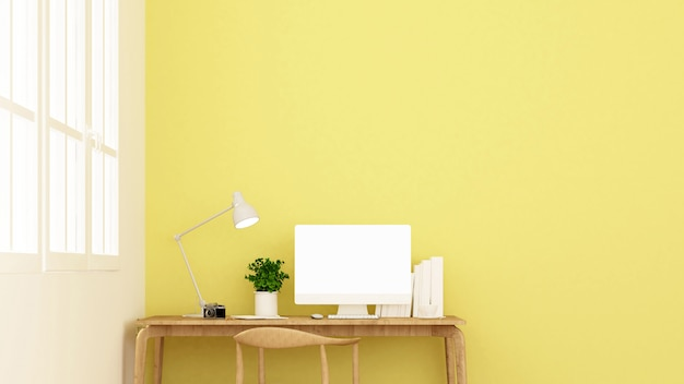 Workplace and yellow wall decorate.