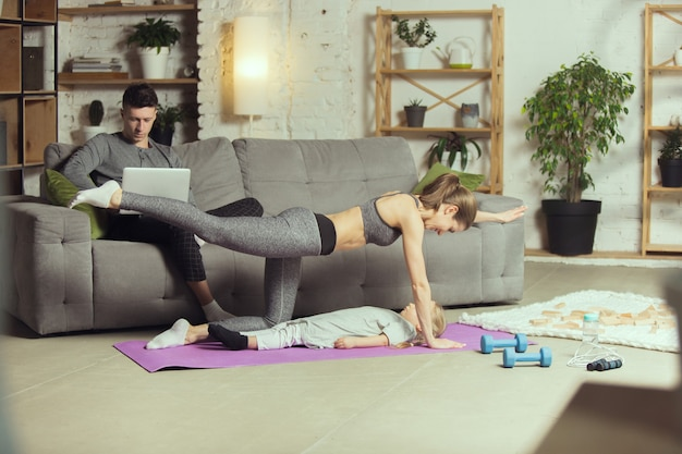 Works her legs out. young woman exercising fitness, aerobic, yoga at home, sporty lifestyle and home gym