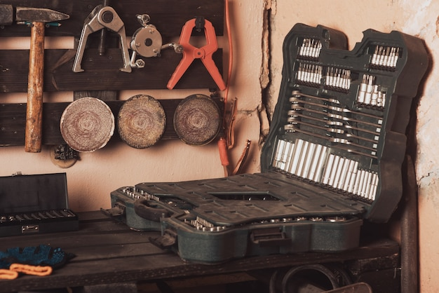 Workshop scene. tools on the table and board. garage, car shop. special vehicle repair tool