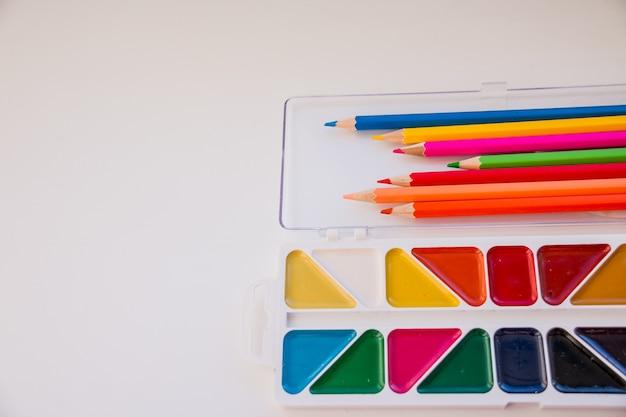 The workspace. colored pencils, watercolor, paints