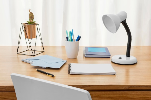 Workspace composition with desk lamp