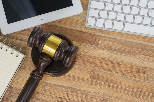 Workspace hero header with law gawel, top view, copy space on wooden table background