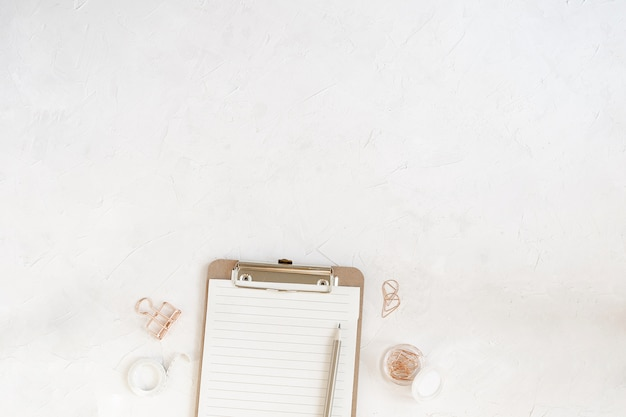 Workspace mockup, clipboard with blank paper, cotton branch