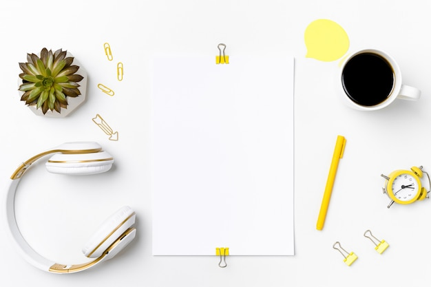 Workspace mockup with blank paper and stationary